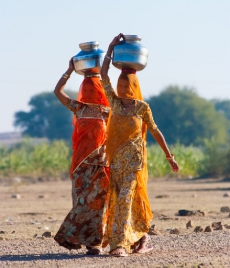 Indian women from Rajasthan carry water over long distances due to lack of safe water sources