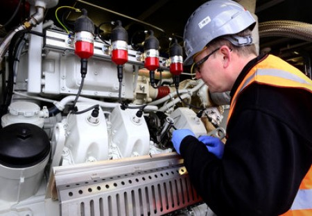 Inspecting a 350Kw combined heat & power (CHP) engine at the Andigestion AD facility in Bishop's Cleeve