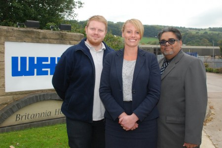 The University of Huddersfield's Professor Rakesh Mishra (right) with Weir's Matthew Charlton and Joanne Hirst (via the University of Huddersfield)