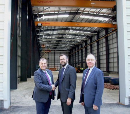 TUV NEL's completed base building that will house its £16 million Advanced Multiphase Facility. Left to right: CEO of TUV SUD UK & Ireland Brian Austin, property director of HFD Property Group Limited Matt Bellshaw and TUV SUD UK & Ireland chief financial officer William McKnight (via TUV SUD NEL)