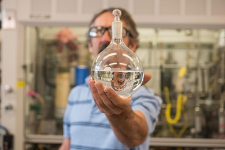 PNNL researcher Rich Hallen helped develop a process that converts ethanol to jet fuel in partnership with LanzaTech. Though the ethanol can be sourced from any raw material, sugar, corn, trash etc., LanzaTech produces ethanol using waste gas emissions from industrial sites. By coupling the waste gas to ethanol and ethanol to jet processes, the team can make industrial waste gases into jet fuel. An international standards body, ASTM, just revised their standard to allow ethanol as a feedstock to produce jet fuel. Credit: PNNL/Andrea Starr