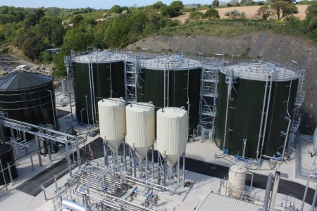 In the foreground, the three pasteurizers at Bellozanne STW on Jersey, which hold sludge at 55 degrees C for a minimum of 4 hours, prior to passing to the three anaerobic digesters (in the background).